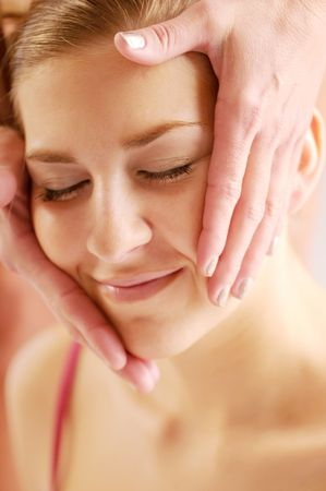 joyousness: The young attractive woman during massage of face.