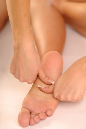 joyousness: The detail of relaxing massage of leg. Stock Photo