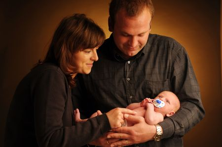 solicitude: The portrait of the parents with little baby.
