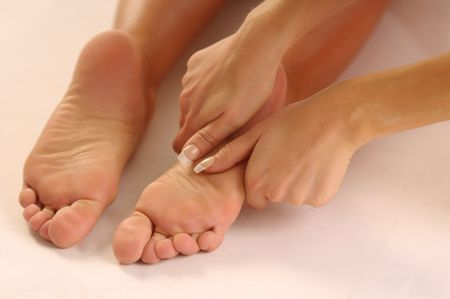 joyousness: The detail of the relax massage of legs.