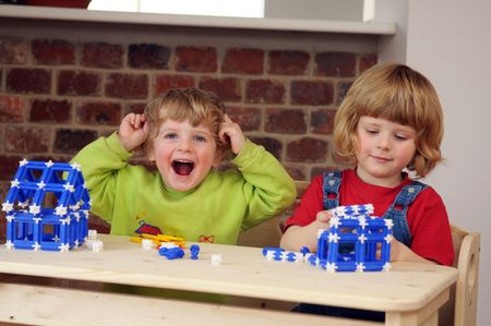 joyousness: The children during the playing with the construction kit . Stock Photo