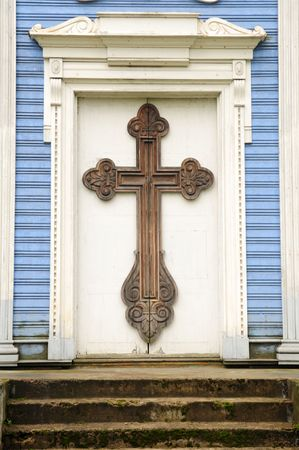 entranceway: The door of the church and cross.