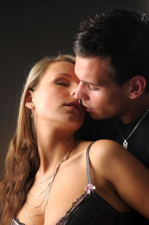 cuddles: The portrait of the attractive young loving pair. Stock Photo