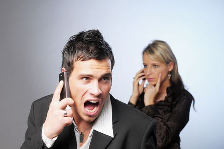 outrage: The portrait of annoyed businessman with telephone. Stock Photo