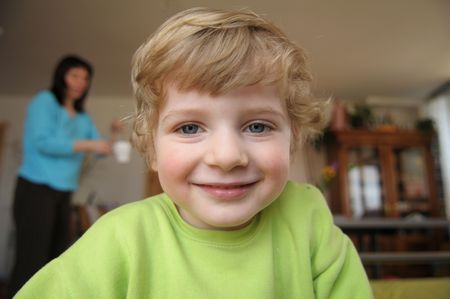 scallywag: The portrait of the little blond boy.
