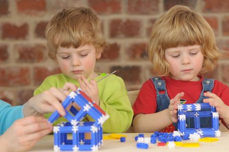 joyousness: The children during the plaing with construction kit. Stock Photo