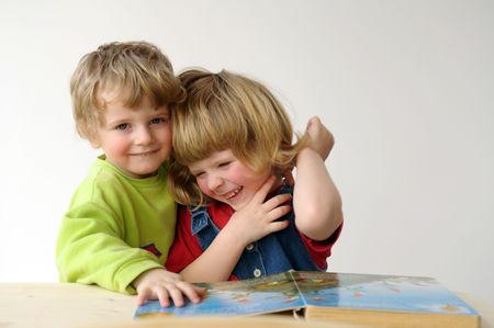 joyousness: the children during reading. Stock Photo