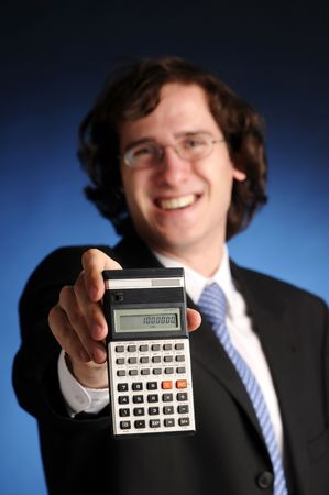 deliberation: The portrait of young attractive businessman with calculator. Stock Photo