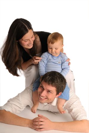The long black-haired mother, father and their little boy Stock Photo - 6362283