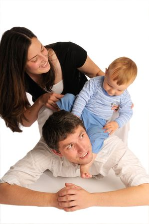 The long black-haired mother, father and their little boy Stock Photo - 6362279