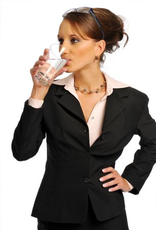 Atractive business woman in formal clothes with glass of water photo