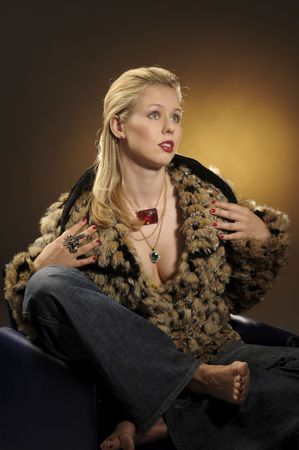 The portrait of attractive blond woman in fur coat photo