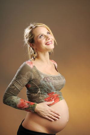 The portrait of beautiful pregnant woman in gray T-shirt photo