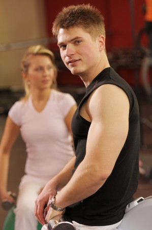 anaerobic: The attractive young man in training in fitness centre Stock Photo