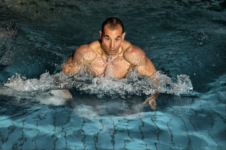 beefcake: The attractive young man during the swimming in swimming pool