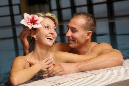 beefcake: The young beautiful pair in swimming pool