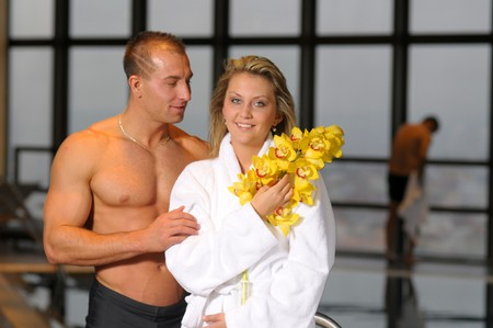 beefcake: The young beautiful pair with flower in swimming pool