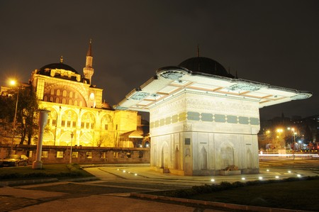 spotlit: The spotlit monument before the mosque in Istanbul at night Stock Photo