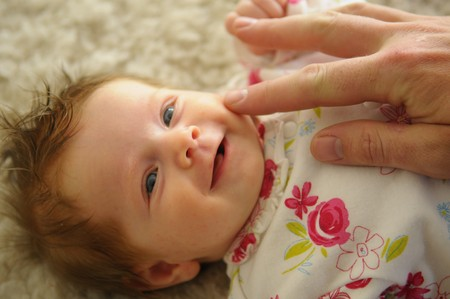 nursling: The portrait of the little smiling baby
