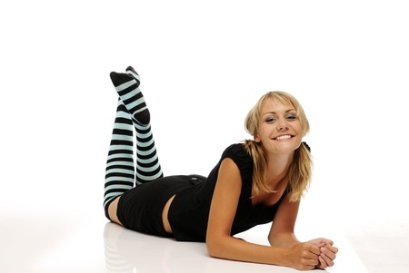appealing attractive: The beautiful smiling young blonde woman with stripy socks on white background