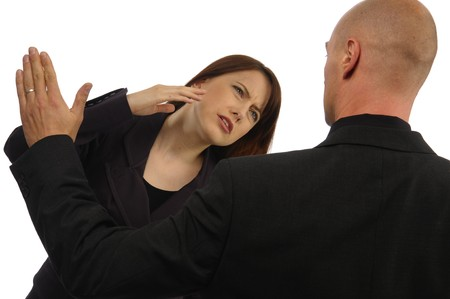 Skirmish of two colleague in dark suit on white background photo