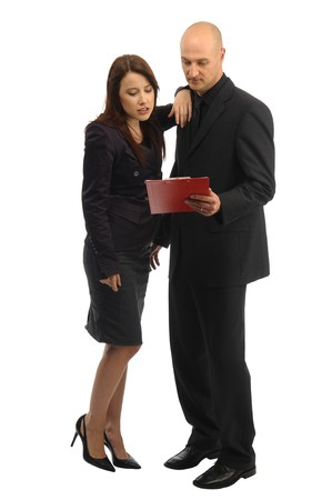 Woman in dark suit and colleague with red desks on white background Stock Photo - 8341851