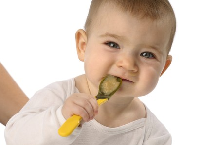 supervosory mother on feeding baby