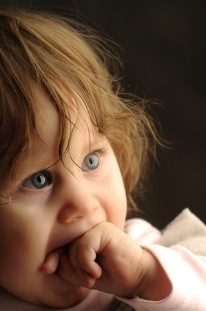Portret a little girl on dark background photo