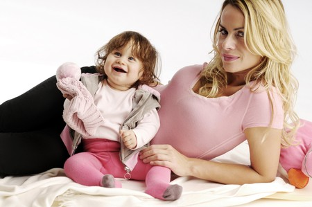 Blond woman lying and playing with the little girl  photo