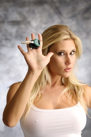 Blond woman with the key in a white undershirt Stock Photo