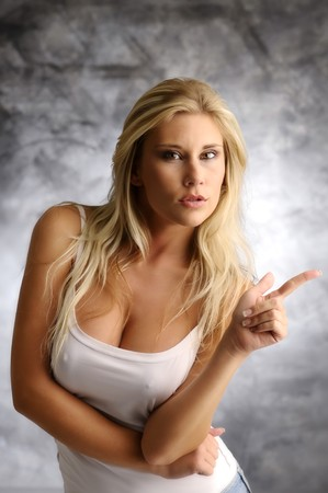 nice breast: Strict blond girl in a white shirt Stock Photo