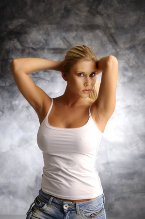 back straight: Blonde girl in white shirt on smoky background