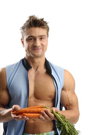 pezones: Hombre con una zanahoria sobre fondo blanco Foto de archivo