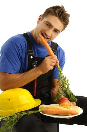 Young manual worker eating healthy snack photo