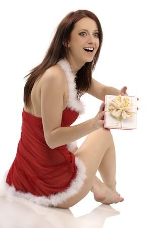 Cute santa girl with christmas present Stock Photo - 9141713