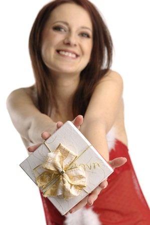 Cute santa girl with christmas present photo
