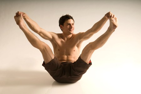 Stretching young man Stock Photo - 8342241