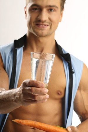 A man with carrot and glass of watter Stock Photo - 8086043