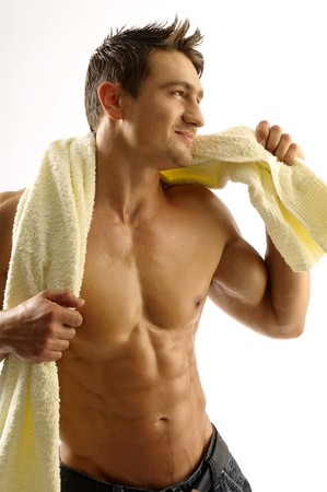 A young man with a towel Stock Photo - 8086037