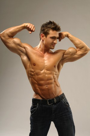 Athletic man showing muscles photo