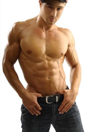 Attractive sportman in jeans photo