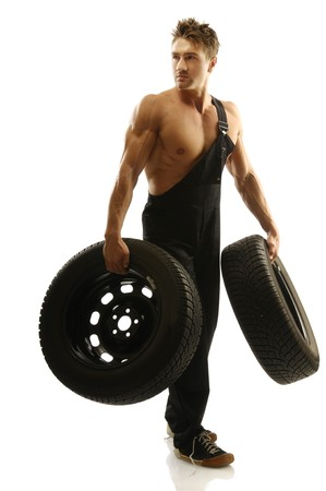 A man with a car tire  Stock Photo - 14825036