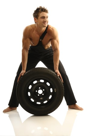 Man carries tires photo