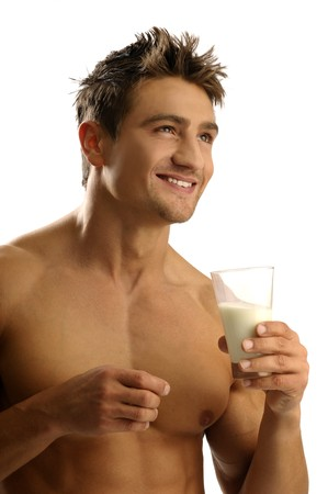 Young athletic man having milk