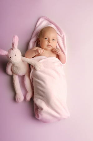 endearing: A little newly born baby with toys