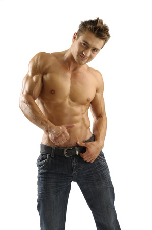 An attractive strong man posing in jeans photo