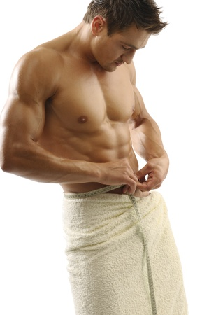 An attractive strong man wrapped in towel photo