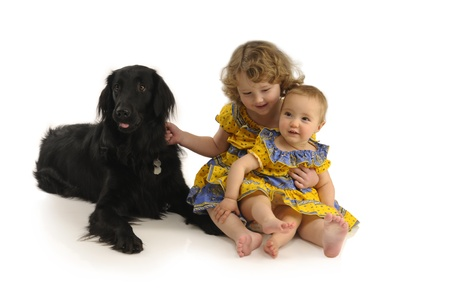 Two little girls guarded by a black dog Stock Photo - 9153969