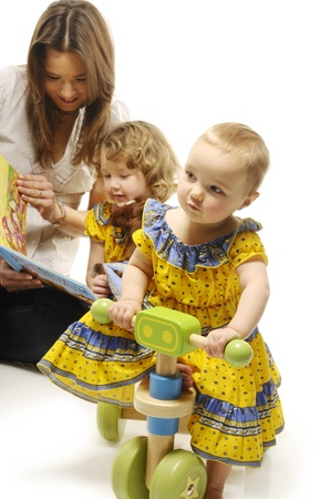 Two little girls and young mother reading fairy tale Stock Photo - 9154401