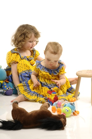 Two little girls playing with toys Stock Photo - 9154427